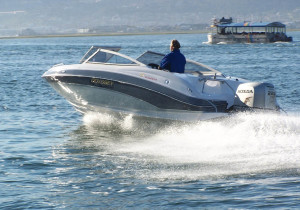 BOAT-REVIEW-RIGHT-Odyssey-650-Sundeck-+-BF225-Action-passing-rear-side-view-copy